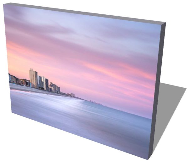 canvas print of the Garden City shore line in South Carolina, showing the highrises with sunset colors and a wide ocean view