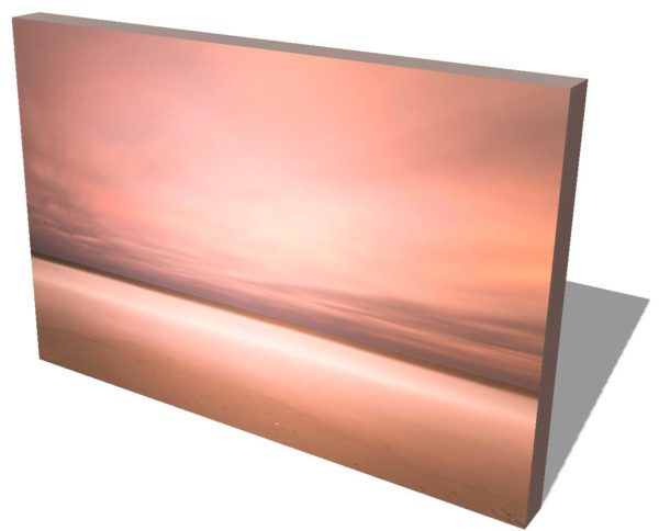 long exposure view of the ocean with beach in the foreground, orange sunset clouds creating an abstract view