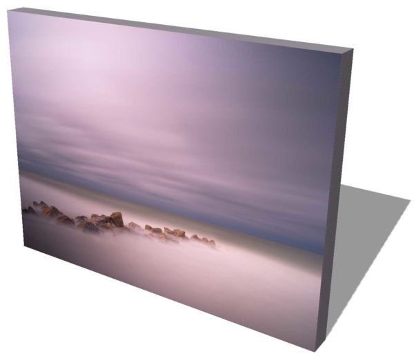 canvas print of a rocky groin with deep purple after sunset colors, an abstract view created by a long exposure photography technique
