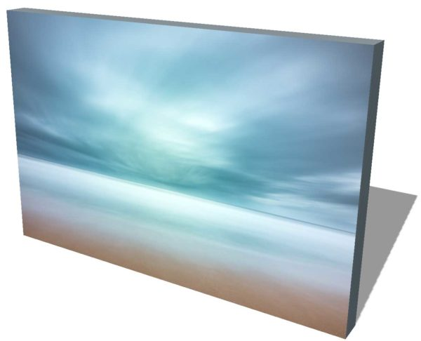 canvas print of a wide view of the beach and ocean, blue strormy cloud cover creating an abstract view by the long exposure effect