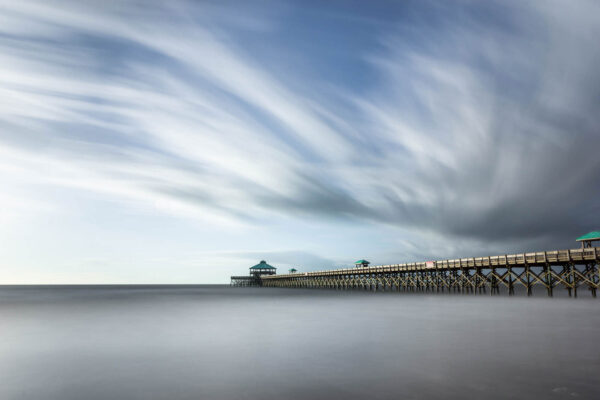 Long exposure photograph of a the Folly Beach Pier before the tear down, South Carolina, before sunset hours, by Ivo Kerssemakers